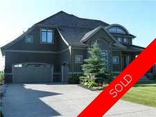 Gorgeous and luxury  home on a gorgeous lot backing onto the lake at Heritage Pointe with private schools nearby presented by Sotheby's International Realty Canada